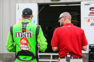 Breath (right) and NASCAR driver Kyle Busch at the May 2015 All-Star race in Charlotte, Busch's first race back in the car after his injury.