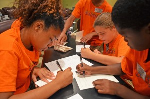 Leadership Academy students write thank you notes to the people and organizations they visited during the academy.