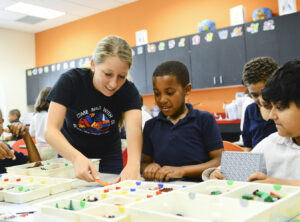 HPU graduate student Kaitlyn Hutter and first-grader Quentin Ayuso building with Legos.