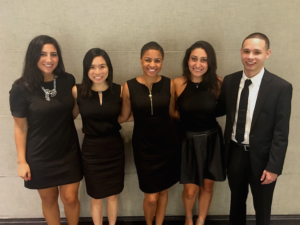 Junior Lexi Becer, fourth from left, poses with her team on the day of finalist presentations for the PVH competition.
