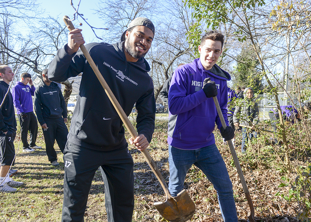HPU students Erien Campbell (left) and Chris Ramsell do landscaping at West End Ministries during last year's Day of Service.