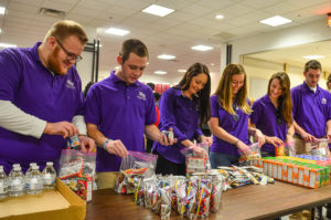 From left to right, HPU students Mason Martin, Jay Whitsett, HPU student success coach Emily Long, Abby Moore, Jessi Gray and Ross Pavlovich pack meals to be distributed to the homeless and United Way agencies on Martin Luther King Jr. Day of Service 2016.