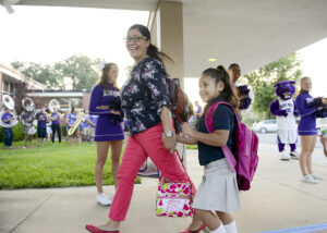 Montlieu Academy of Technology student Camila Delgado and her mother, Lizeth Delgado, being welcomed by High Point University for Montlieu's first day of school.