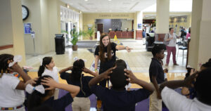 Sophomore Lydia Profili leads Montlieu students in a game of Simon Says.