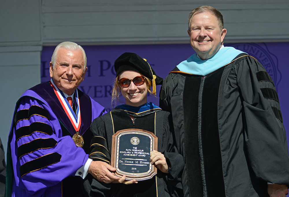 Pictured are Dr. Nido Qubein, president of High Point University; Dr. Nicole Hughes, assistant professor of biology; and Dr. Dennis Carroll, provost and vice president for Academic Affairs.