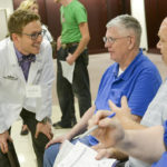 Dr. Jordan Smith (left), professor of clinical sciences at HPU, spoke to community members Mike Branning (center) and Gregory Bowers (right) at the April event.