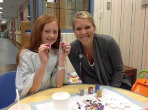 Chloe, 12, and Natalie Page make test tube sparkle sticks.