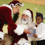 Every child at the Boys and Girls Club met with Santa and Mrs. Clause to receive a gift.