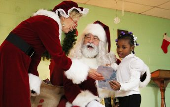 Business Fraternity Hosts Holiday Party for Boys and Girls Club