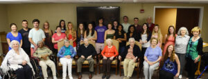 HPU students and residents of Pennybryn at Maryfield at the end-of-the-year poetry celebration.