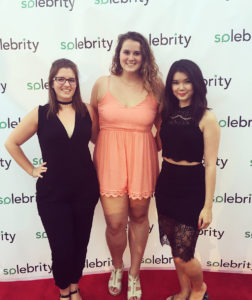Kirstie Pratt (center) poses for a photo with fellow interns Michele Byers (left) and Angela Pathammavong (right) at a DC Swim Week red carpet event held at the Penthouse Pool and Lounge in Washington, D.C.