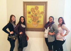 "Students Abigail Hansen, Melanie Thompson, Alexandra Cree and Elizabeth O'Brien view Vincent van Gogh's ""Sunflowers"" painting in the Van Gogh Museum in Amsterdam, Netherlands."