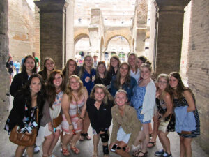 Students pause for a photo during a guided tour of the Coliseum in Rome, Italy.
