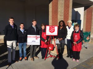 Members of HPU's Student Government Association in front of the Red Kettle that they sponsored this holiday season.