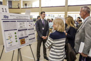 HPU student Shane Gregory presents his research on bacterial antibiotic resistance.