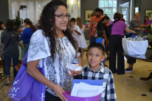 Rodrigo Lopez and his mom, Evanelina Lopez-Arevalo, enjoy the Summer Reading Institute's Family Night.