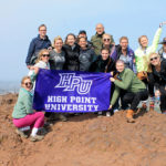 "High Point University students enrolled in the ""Maymester"" literature course visit Arthur's Seat during their trip to Scotland."
