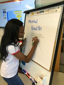 Pictured is Shirley Garrett discussing mental health during a presentation