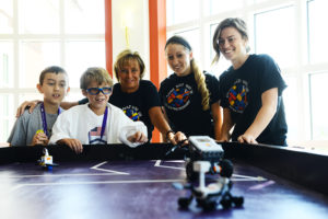 From left to right, HPU STEM Camp participants Cyrus Hartley and Cameron Hodger, Disseler, and HPU graduate students Kaitlyn Hutter and Lisa Tripp work with Lego robotics at the STEM Camp last summer.