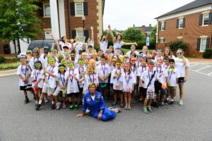 HPU STEM Camp participants, HPU graduate students and Disseler, are featured at the rocket launch for the first-ever HPU STEM Camp last summer.