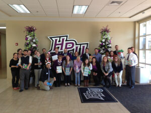 HPU Office of Student Life staff with the gifts they gave to the Family Services of the Piedmont.