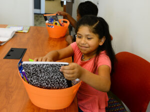 Montlieu Academy third grader Allison Estraeda going through her reading materials.
