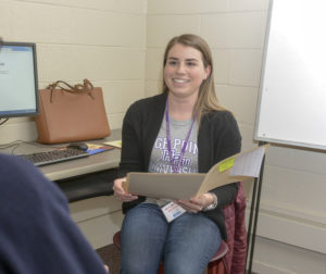 HPU student Kristine Faxlanger helps a community member file their taxes for free.