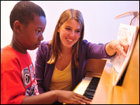 Student Begins Program Offering Free Music Lessons to Children in Community
