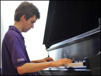 Students Tickle The Ivories Of Prestigious Grand Piano