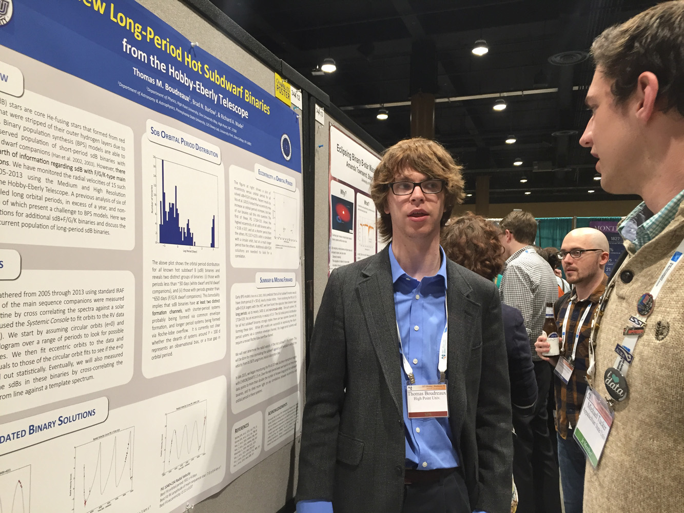 Thomas Boudreaux, left, shares his research with Michael Tucker, an astronomy undergraduate student from Appalachian State University.