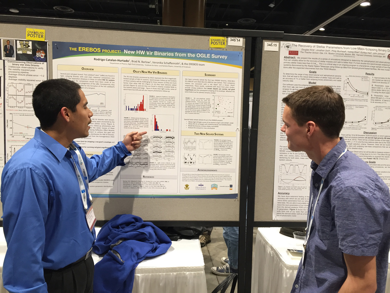 Rodrigo Catalan, left, talks about his research with a graduate student at the meeting.