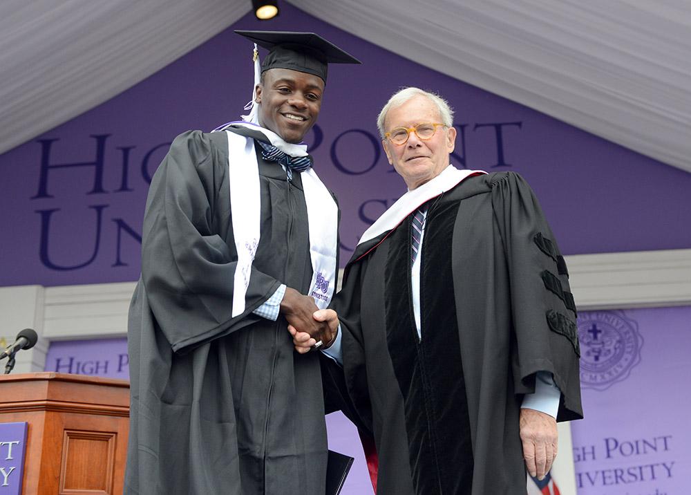 Brokaw shakes the hand of Sonny Mukungu as he graduates.