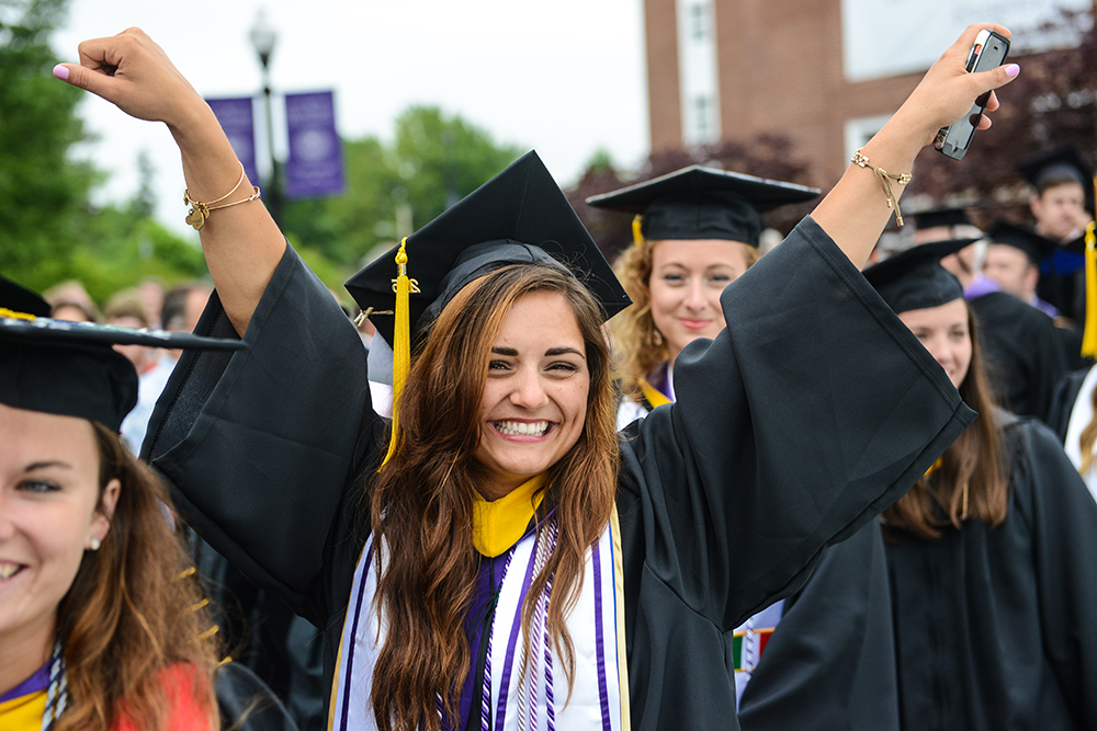 Nicole Karlesky cheers as she walks to the stage to receive her degree .