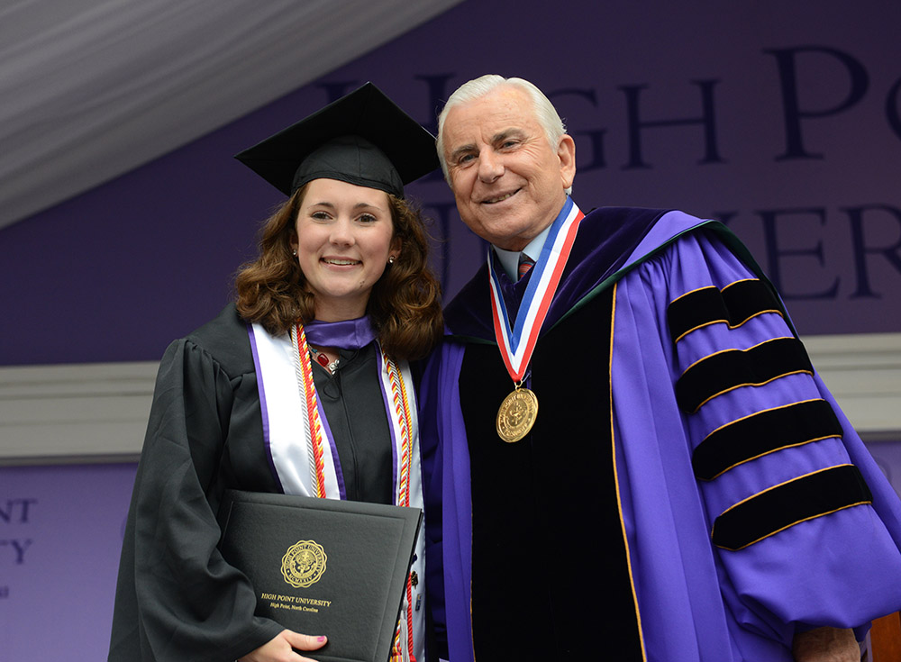 HPU President Dr. Nido Qubein shakes the hands of Erin Karpovich as she crosses the stage.