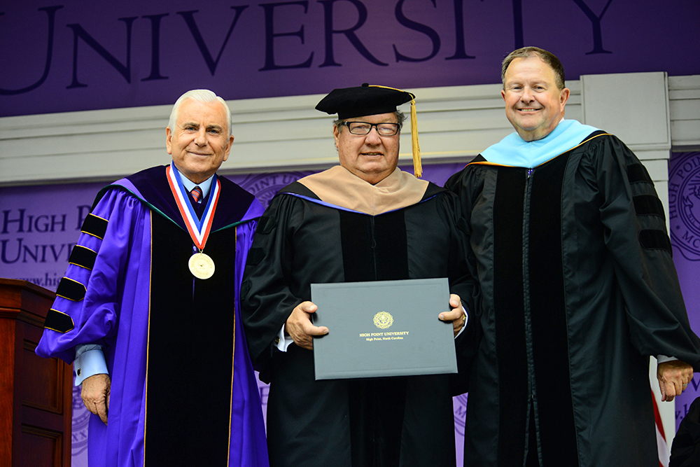 Ron Wanek, founder of Ashley Furniture, receives an honorary doctorate degree in business from Qubein (left) and Dr. Dennis Carroll, HPU provost (right).
