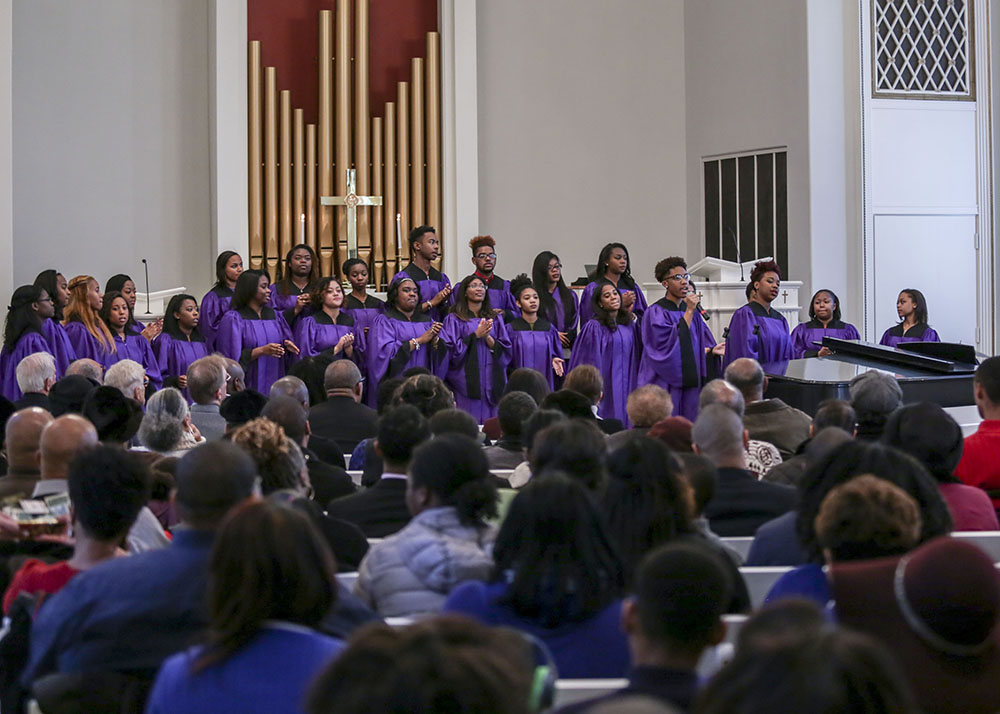 The Genesis Gospel Choir provides the music for the service.