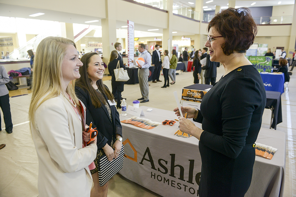 HPU students Mary Schofield (left) and Alexa Burger (center) discuss opportunities at Ashley Furniture with Heather Vogel (right), director of organization development and research for the company.