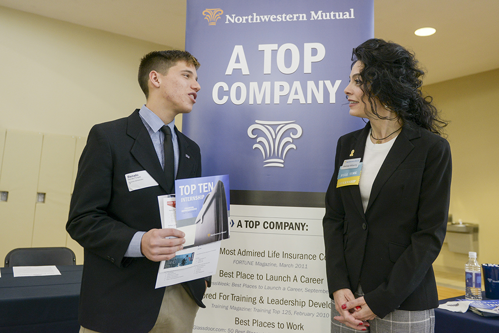 Renato Punyed (left), HPU student, discusses job opportunities at Northwestern Mutual with Melissa Newman, director of recruitment at the company.