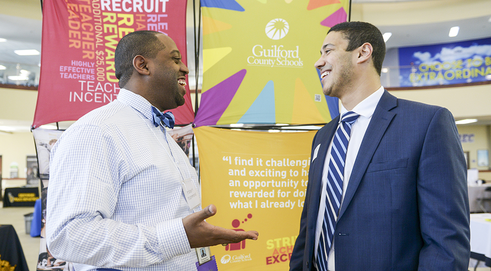 Robert Richmond (left), recruiting manager for Guilford County Schools, speaks to HPU student Vincent Perez at the HPU Career and Internship Expo.