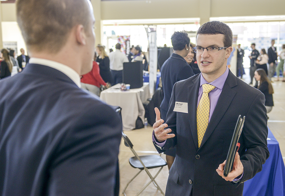HPU student Michael Ryan networks at the Career and Internship Expo.