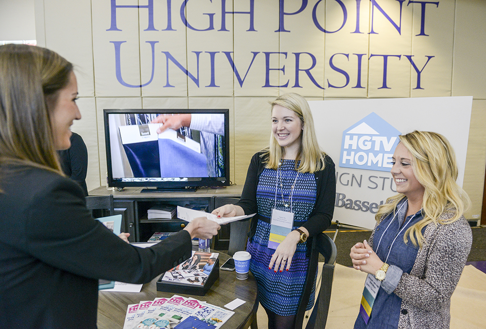 HPU alumnae and Bassett Furniture employees Virginia Ellis (left) and Erin Raleigh (right) speak with current HPU students about career and internship opportunities at the company.