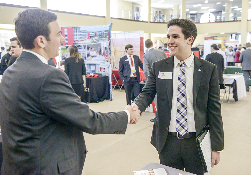 HPU student James Ensor (right) speaks with L Tate Sasser, credit analysis team leader at BB&T, about internship opportunities with the company.