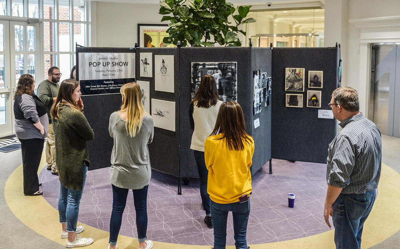 Senior studio art majors organized a pop up show in Cottrell Hall.