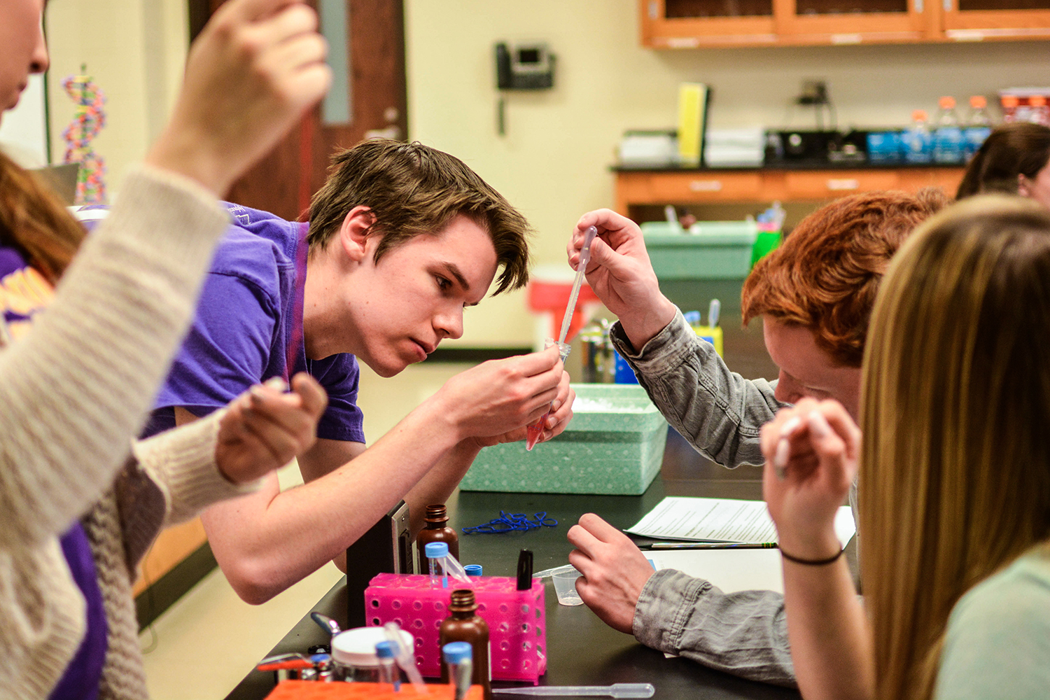 HPU students guided high schoolers from Penn-Griffin through science experiments in Congdon Hall.